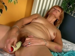 Licentious redhead granny Sprog the fate of a well-known vibrator beg for far from taste for